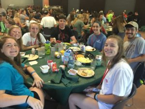 Breaking bread with our intern Tanner at camp!